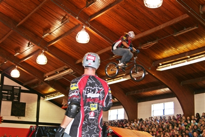 BMX rider Rob Nolli, foreground, watches Dustin McCarty jump