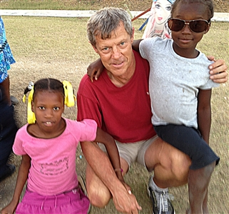 Pilot Steve Koch with two Hatian children