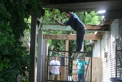 Michael Clymer of Eastern Pennsylvania Conference removes rotted beams