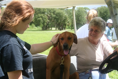 Camper Cara Michaud visits with Riverside director Martha Pierce and her dog