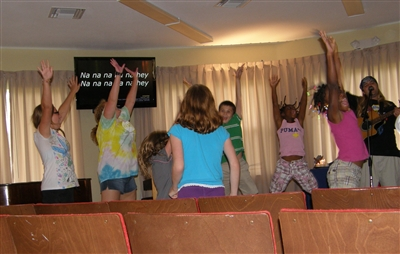 Riverside summer campers participate in worship