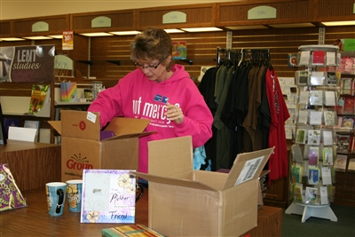 Store manager Dawn Hood packs up Cokesbury store