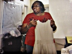 Dorothy Moore holds Jumpers for Joy school uniform