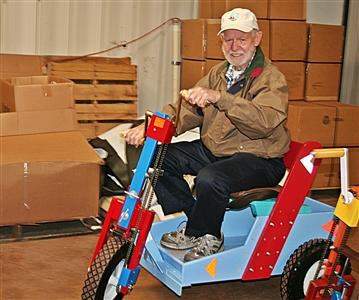 Larry Hills wheels a PET unit into place at PET Project, Penney Farms