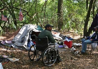 "Daniel, a homeless man, visits the camp of homeless veteran ""Caveman"""