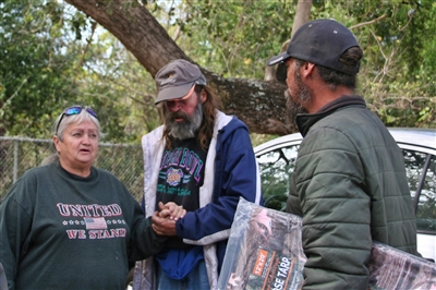 Janet Spivey, left, with Caveman and Daniel, both homeless