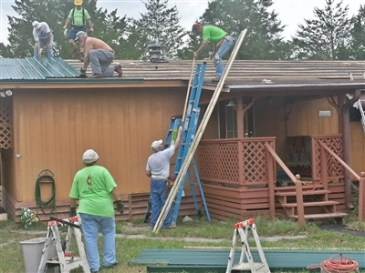 Methodists work with other volunteers to repair damage from Tropical Storm Debby