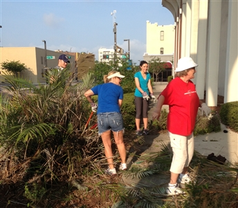 Volunteers from Hyde Park UMC cleanup grounds at Downtown Ministry