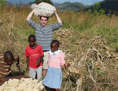FGCU student Chris Mosteiro visits with children in Africa