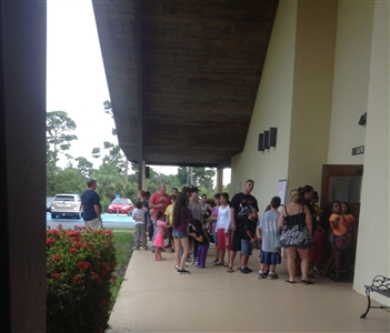 Reigstration line outside Trinity UMC, Jensen Beach