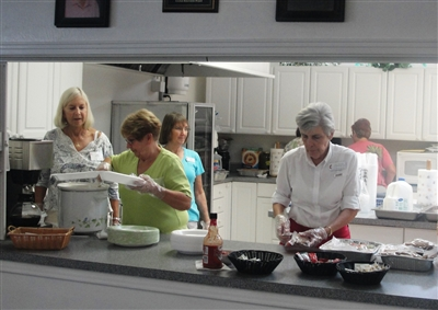 Volunteers prepare food to feed students at First UMC, Bonita Springs