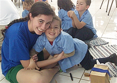 Megan Guyton hugs student during Gator Wesley mission to Costa Rica