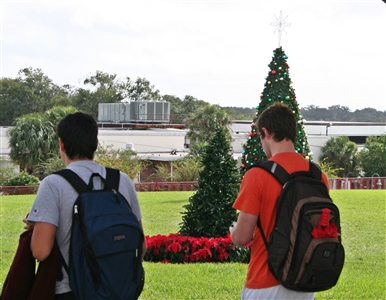 Students walking across college campus at Christmas