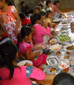 Lao children enjoy a Christmas meal