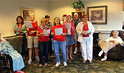 Palm Harbor UMC carolers perform at assisted living facility