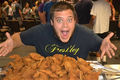Patrick Gardner, Wesley ministry student, prepares to dive into church-supplied wings