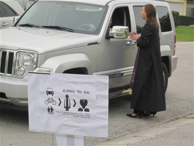 Rev. Emily Oliver approaches motorist who pulled in for Ashes to Go