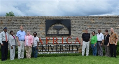 Florida Conference group in front of Africa University sign