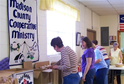 Madison County Cooperative Ministry volunteers pack snack bags