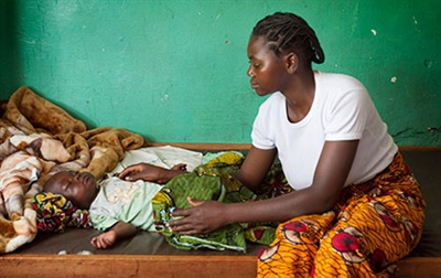 Mother tends daughter with malaria in the Republic of Congo