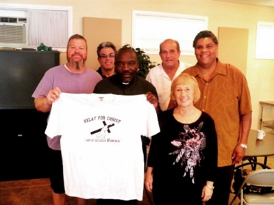 Pastors from the Florida Keys show a Relay for Christ T-shirt