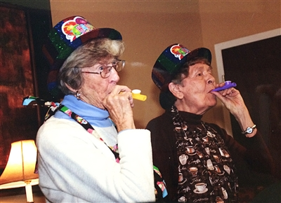 Saints Alive members celebrate at a party