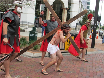Joe Stevens portrays Jesus bearing the cross in downtown Tampa