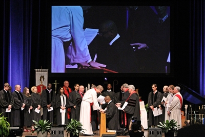 Bishop Carter lays hands of blessing on ordinand