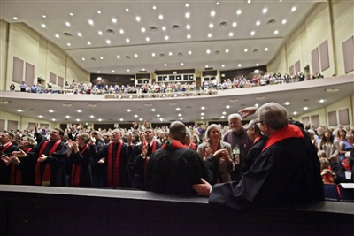 Crowd packs Youkey Theatre for ordination service