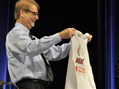 Bishop Ken Carter admires a T-shirt he won for losing at basketball