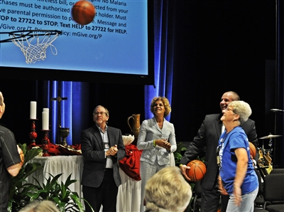 Kay Roach of UMW sinks a basket for Imagine No Malaria