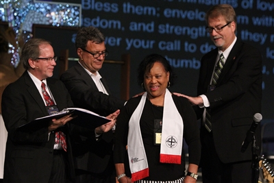 Church leaders lay hands on Mae Griner, new deaconess