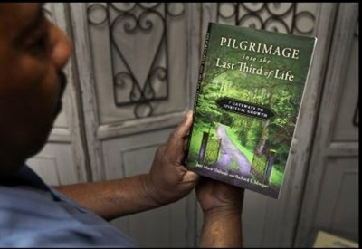 Over the shoulder look at the book Pilgrimage