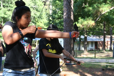 Emely Carrillo, 14, of Gretna prepares to launch an arrow