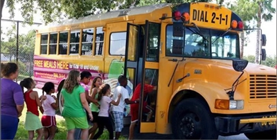 Children boarding a bus headed for a BreakSpot site in Pasco County