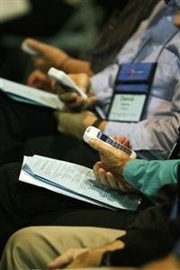 Voters preparing to punch handheld devices to record votes