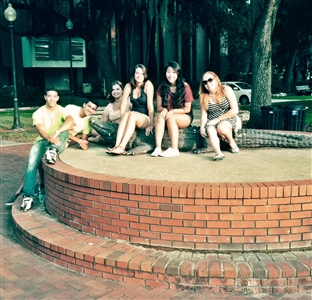 SCREAM troupe from Rutgers pose with gator statue at UF