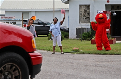 Springhead UMC members wave motorists in for a free carwash