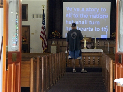 Volunteer gets ready for first Back to Church worship service at Springhead UMC