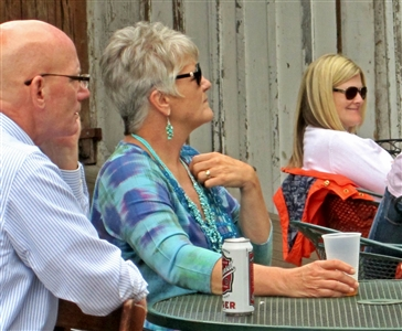 Older couple listening to speaker at outdoor venue