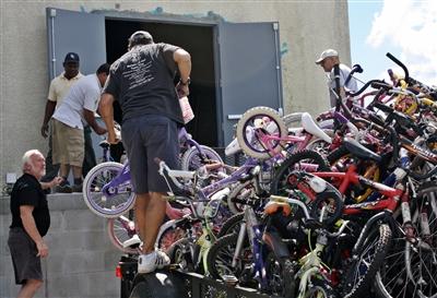 Volunteers at Edgewater UMC bike ministry unload bike donations