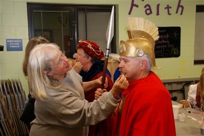 Sherri Taylor of Killearn UMC applies makeup to Roman soldier Ken Tomblin