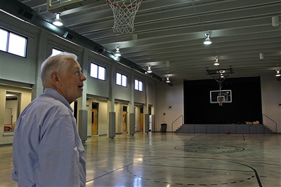Jim McClelland looks over refurbished gym he helped build in the 1950s