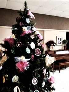 Christmas tree decorated with handmade inspirational ornaments