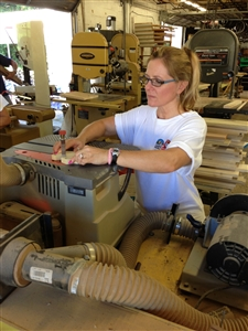 Volunteer working a spindle sander