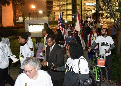 Orlando participants in a city march approach First UMC Orlando