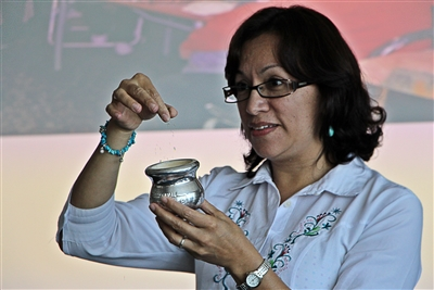 Rev. Rocio Barcenas diplaying Argentinian artifact, the mate