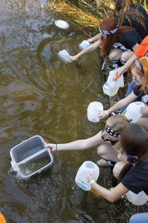 Youths collect water at Lake Griffin