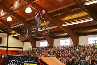 BMX Pros stunt rider Dustin McCarty up high, no hands