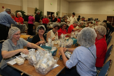 First shift of volunteers Stop Hunger Now packaging